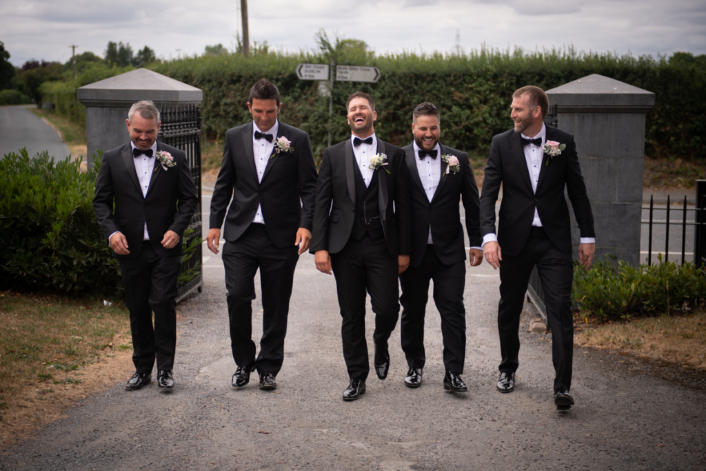 groomsmen walking by wedding photographers the fennells radisson blu wedding