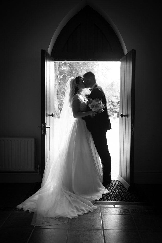 kiss at church door radisson blu wedding