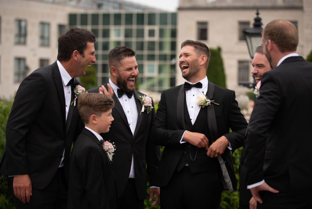 radisson blu wedding groomsmen laughing photo by wedding photographers the fennells