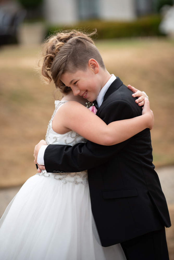 radisson blu wedding pageboy and flower girl hug