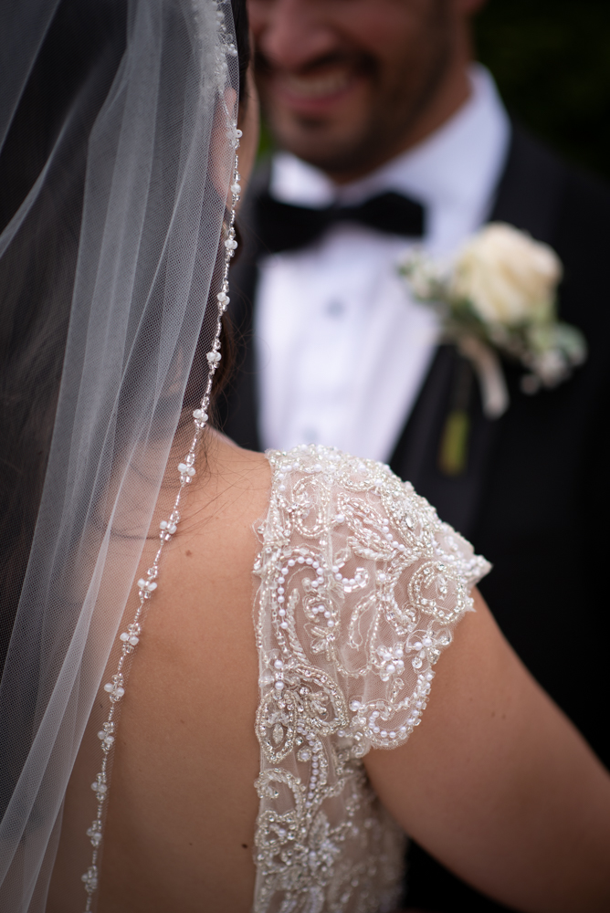 dress details photo by wedding photographers the fennells