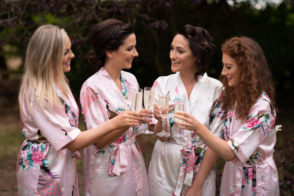 bridesmaids cheers with champagne radisson blu wedding