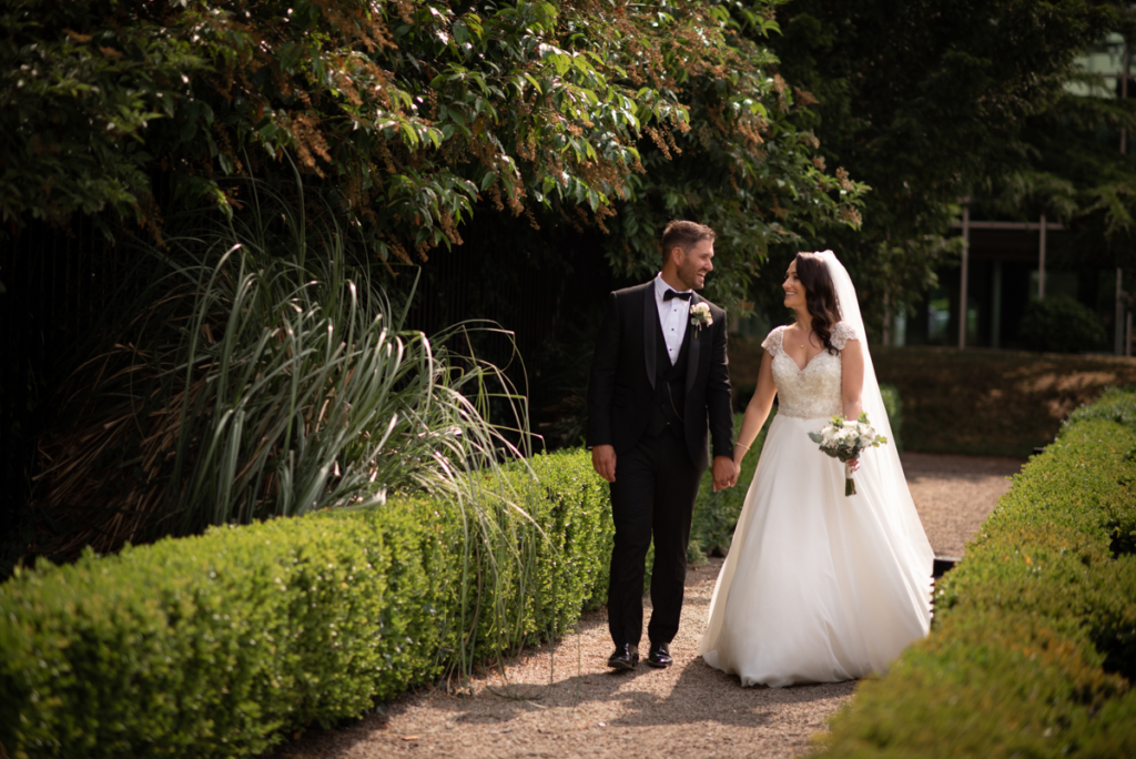 walking in garden photo by wedding photographers the fennells radisson blu wedding
