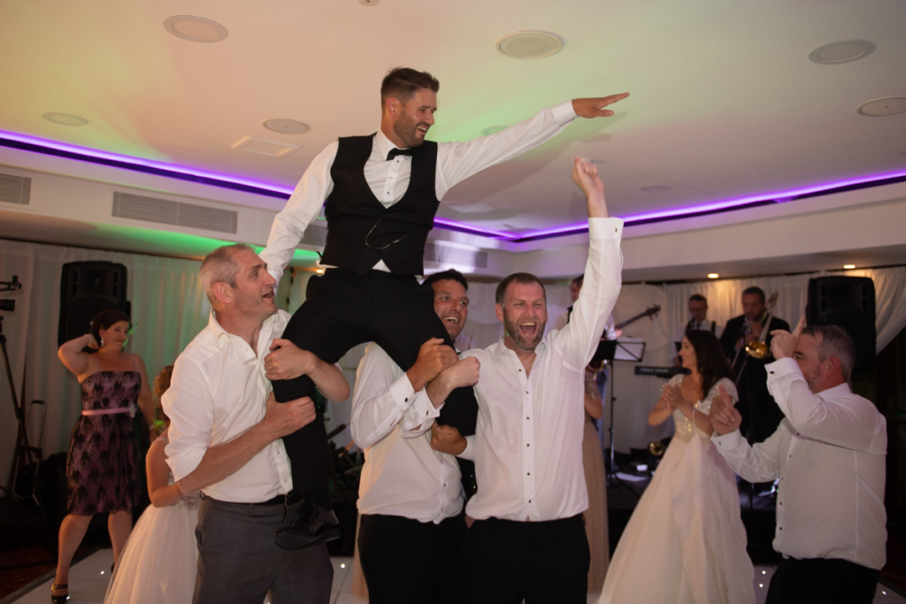 groom dancing on shoulders