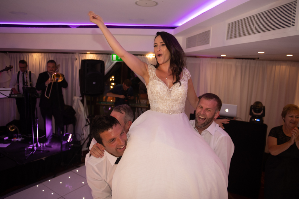 bride dancing on shoulders