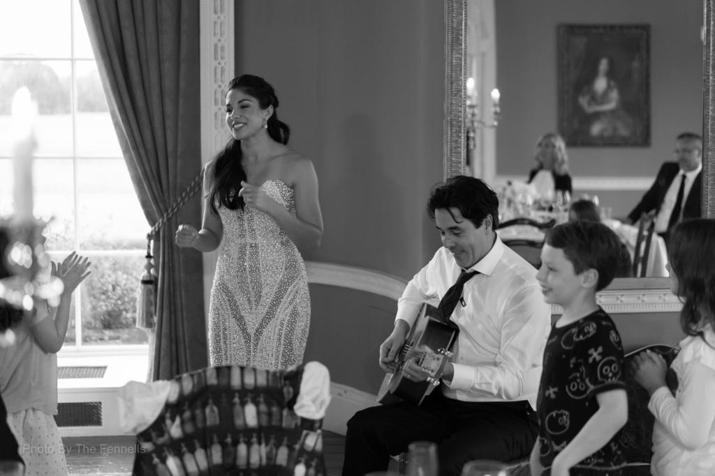 Sarah Roberts singing a song to James Stewart during their wedding speeches