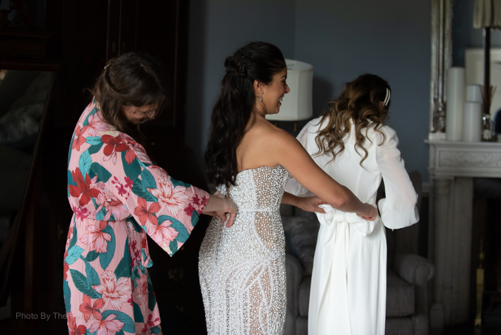 Sarah Roberts tying up her bridesmaids bow on the back of her dress