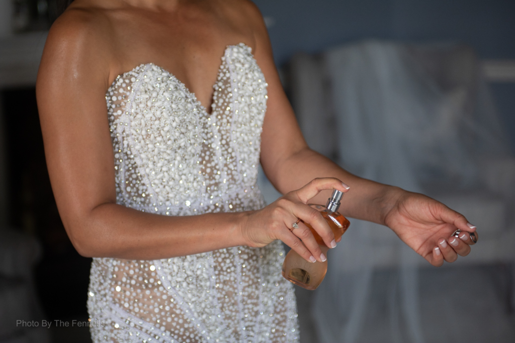 Sarah Roberts putting on her wedding perfume