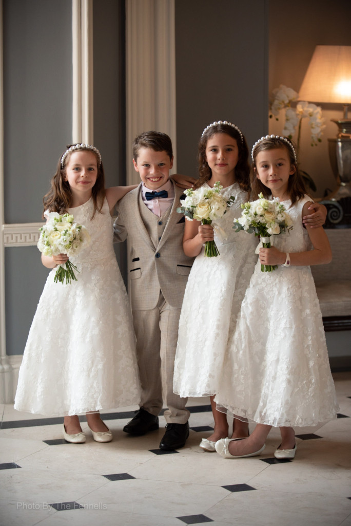The flower girls and page boy for the home and away wedding