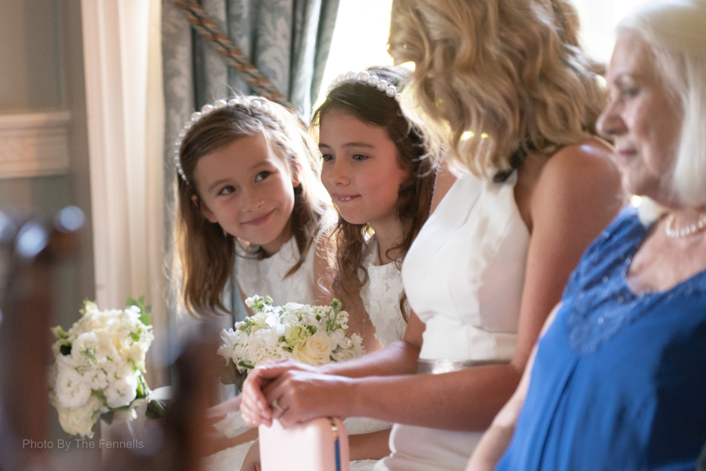 Flower girl and guests during the ceremony at the home and away wedding