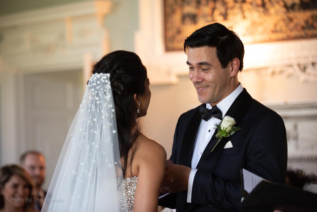 Sarah Roberts and James Stewart saying their wedding vows at their Luttrellstown Castle wedding