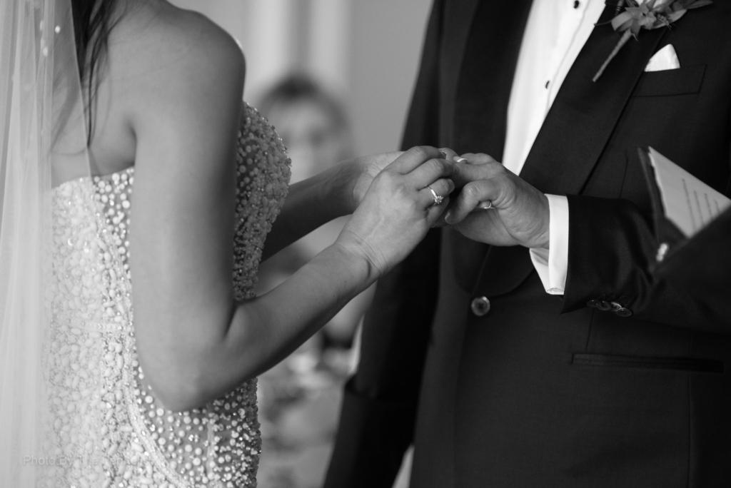 Sarah Roberts putting on James Stewarts wedding ring during their vows