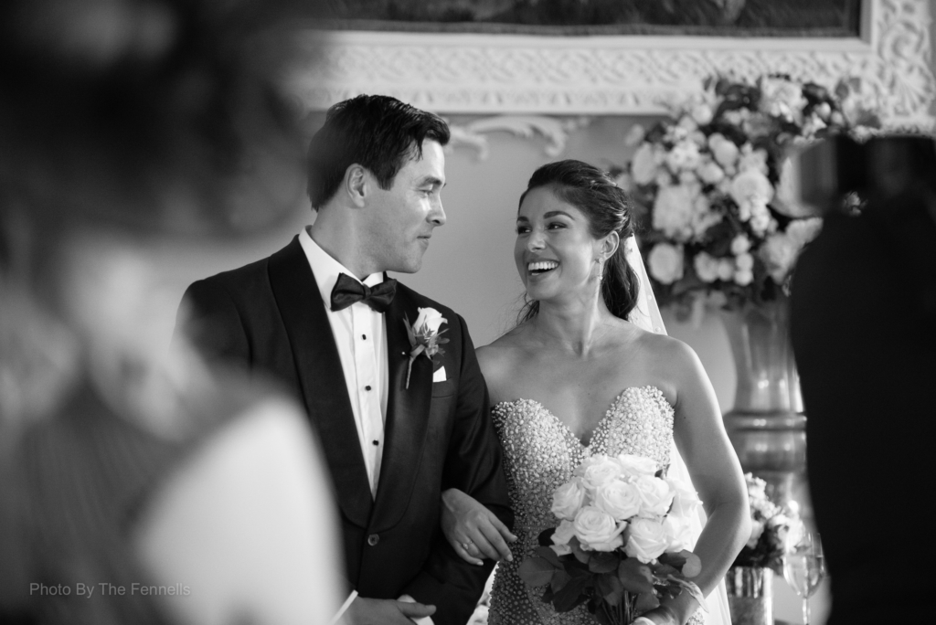 Sarah Roberts and James Stewart looking at each other and smiling at their wedding ceremony