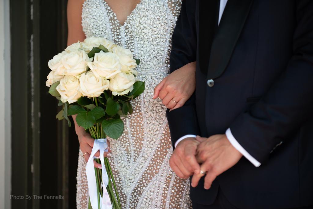 Sarah Roberts linking James Stewarts arm on their wedding day