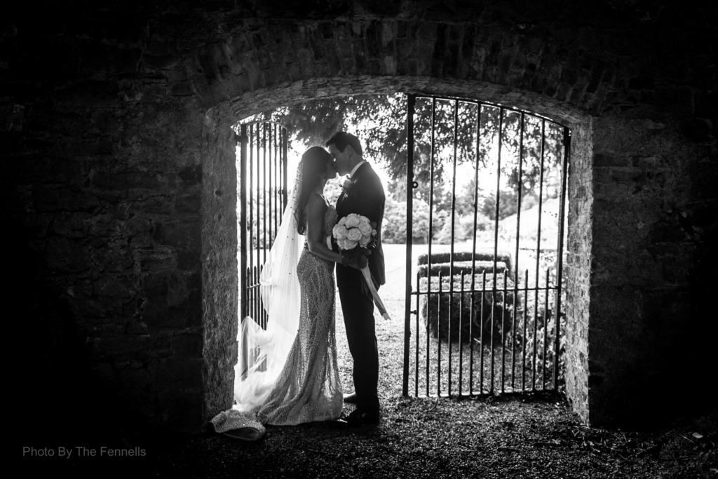 Sarah Roberts and James Stewart by the gates and stone wall at Luttrellstown Castle