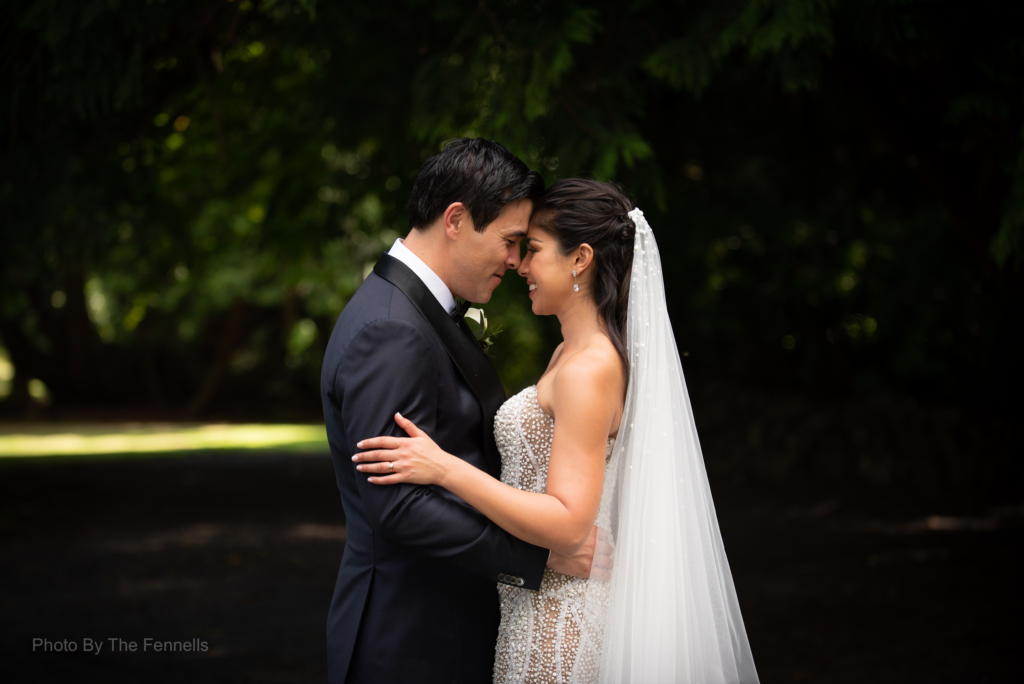 James Stewart and Sarah Roberts hugging with their foreheads touching on their wedding day