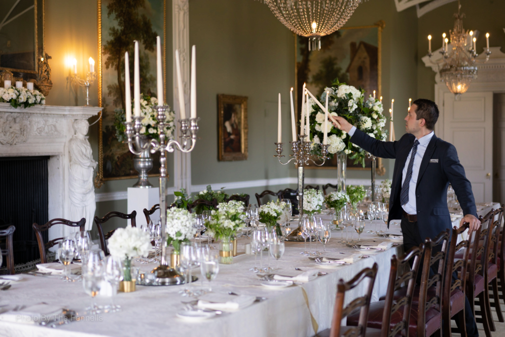 Lighting the candles on the candelabra for the dinner reception for the home and away wedding