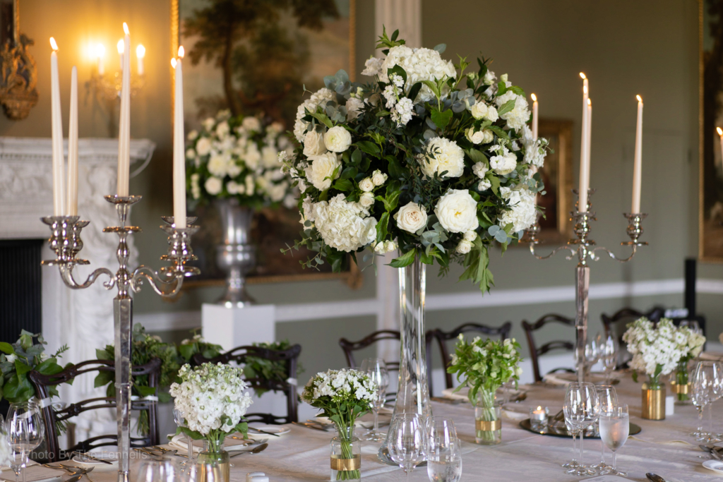 The Dinner table set with candelabras and white flowers for Sarah Roberts and James Stewarts wedding at Luttrellstown