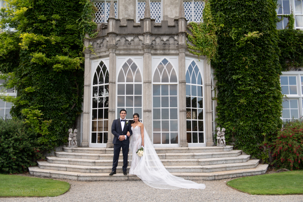 Sarah Roberts and James Stewart standing outside the steps at Luttrellstown Castle