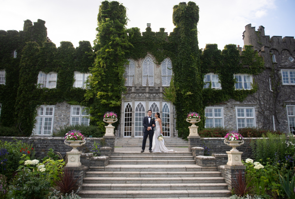 Sarah Roberts and James Stewart standing on the steps at Luttrellstown Castle
