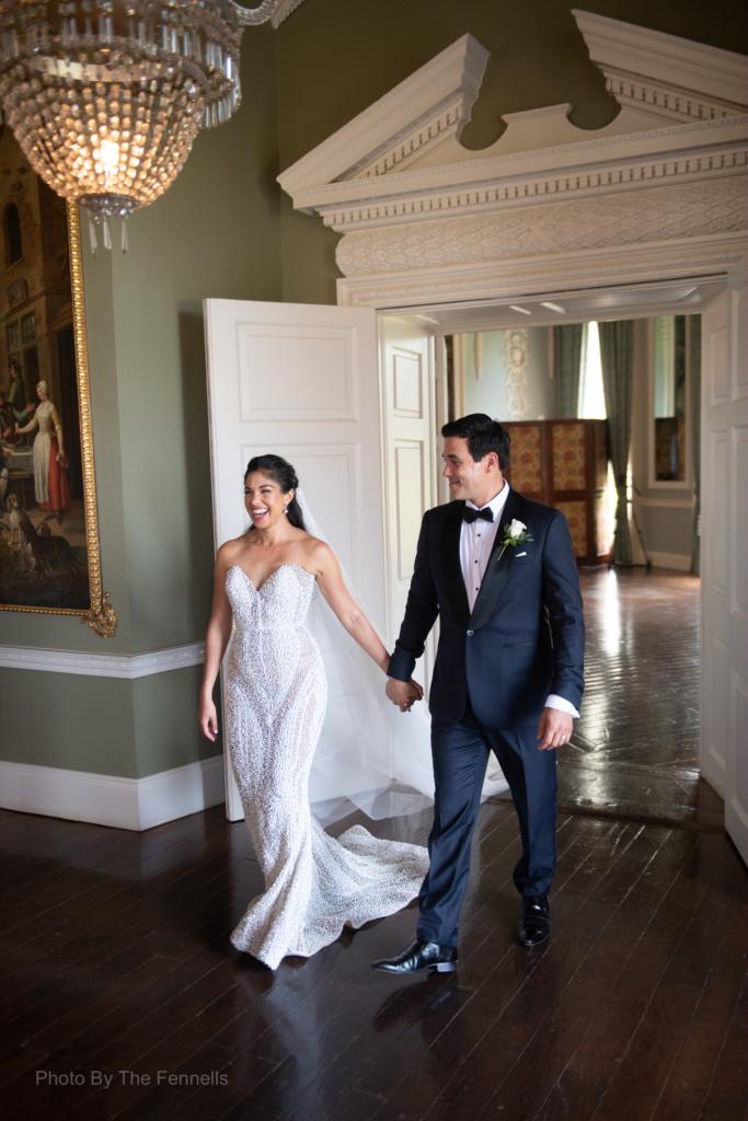 Sarah Roberts and James Stewart walking into their wedding dinner reception at Luttrellstown Castle