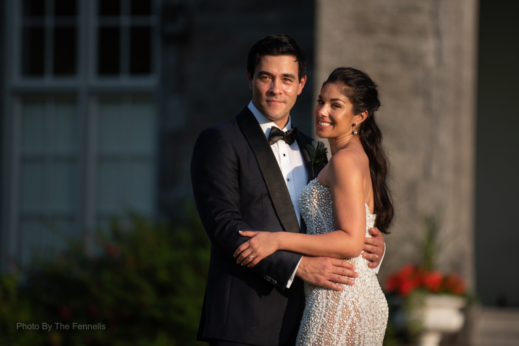 James Stewart and Sarah Roberts outside at Luttrelllstown Castle on their wedding day