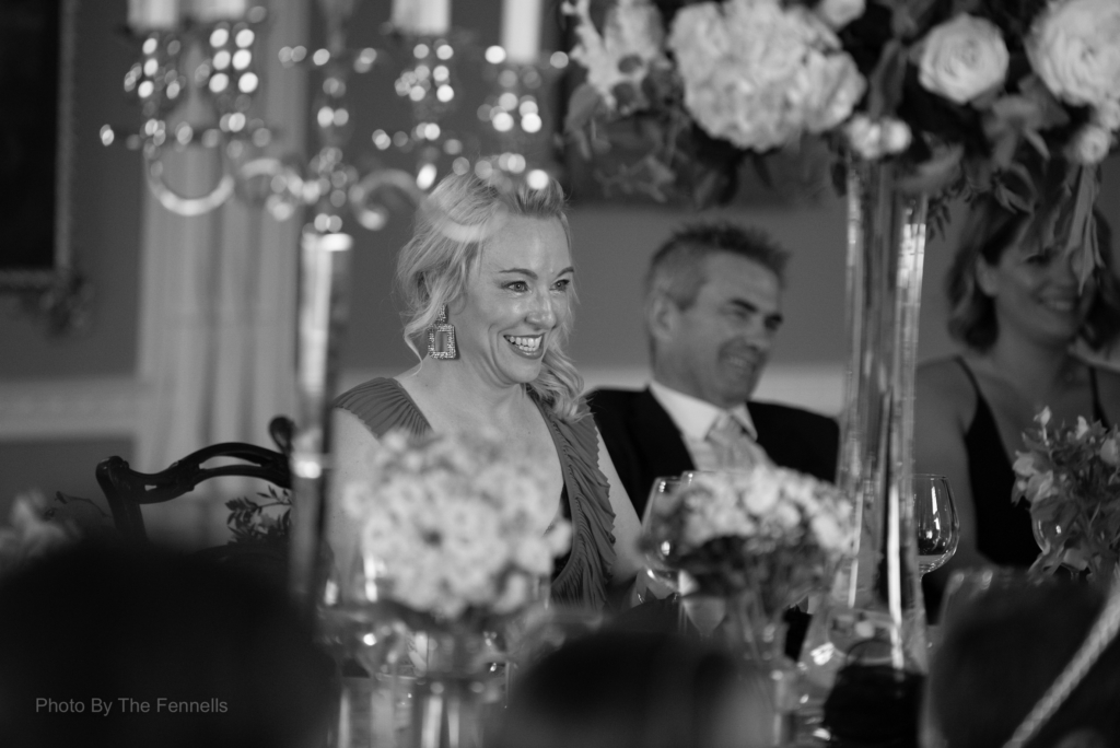 Guests laughing for the wedding speeches