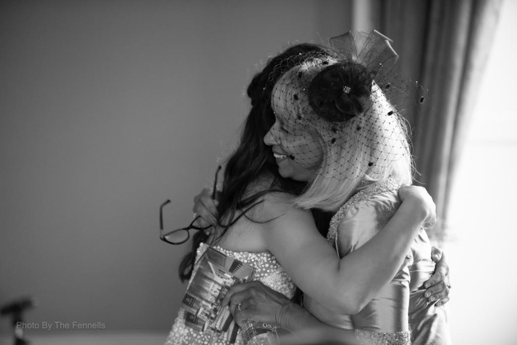 Sarah Roberts and her mum hugging after her wedding speech