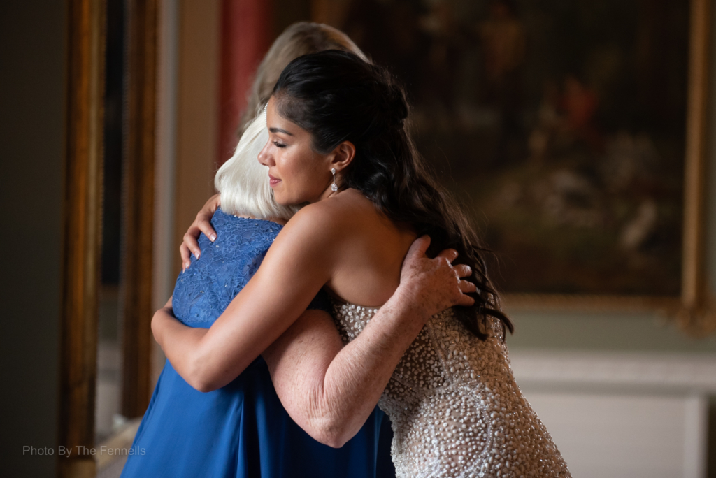 Sarah Roberts hugging her mother in law after her wedding speech