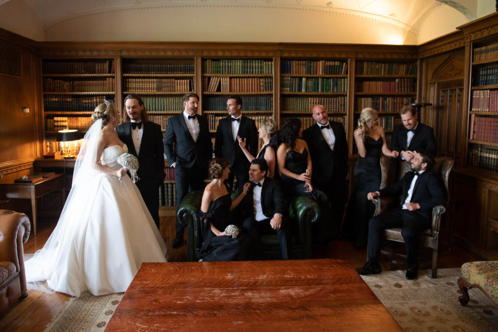 bridal party sitting and talking in luttrellstown castle library