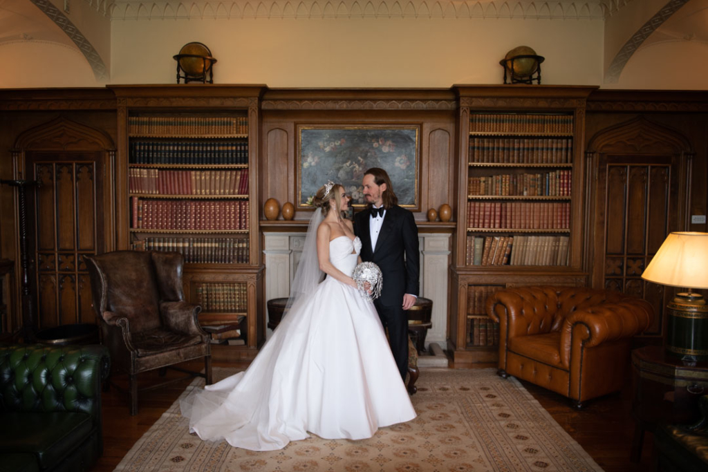 bride and groom standing together in luttrellstown castle library