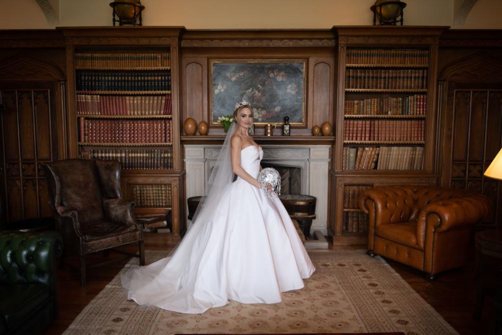 bride wearing Oscar De La Renta wedding dress in luttrellstown castle library