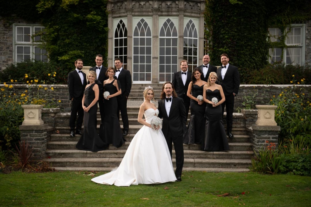 bridal party wearing black on steps at luttrellstown castle in ireland