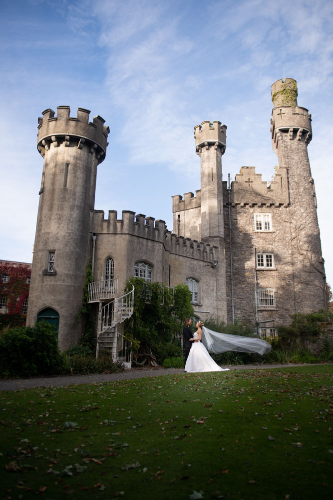 couple standing at tower outside irish castle Luttrellstown