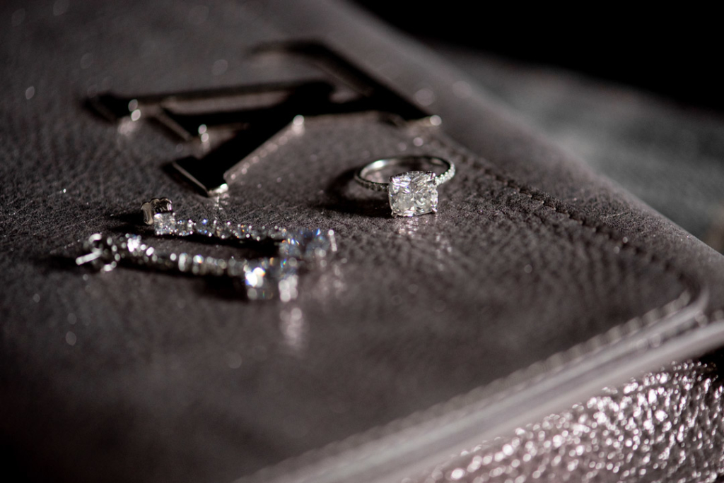 Engagement ring and Brides earrings on Louis Vuitton handbag