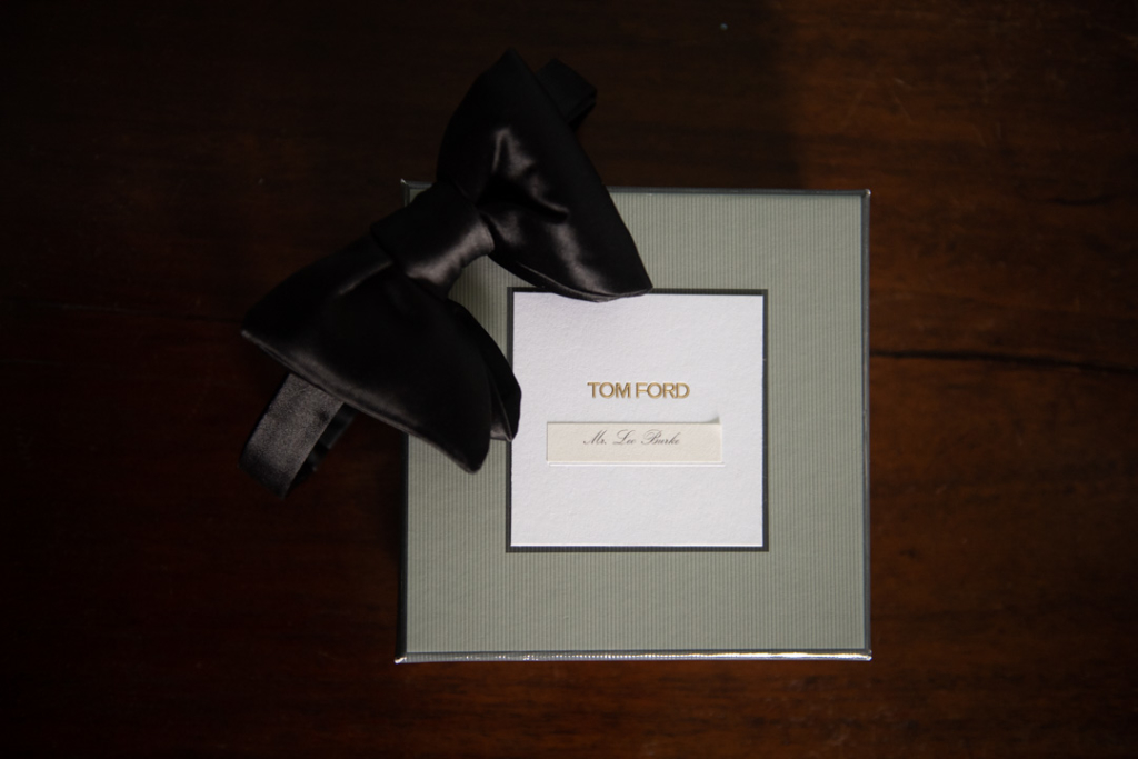 Grooms Tom Ford bow tie on table