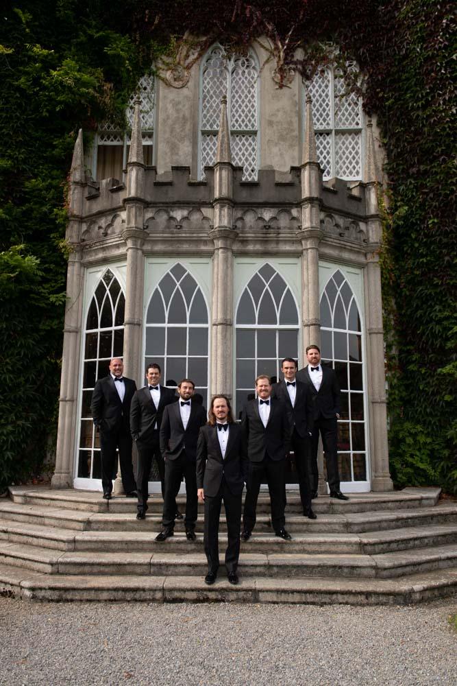 Groom and groomsmen on steps of Luttrellstown Castle