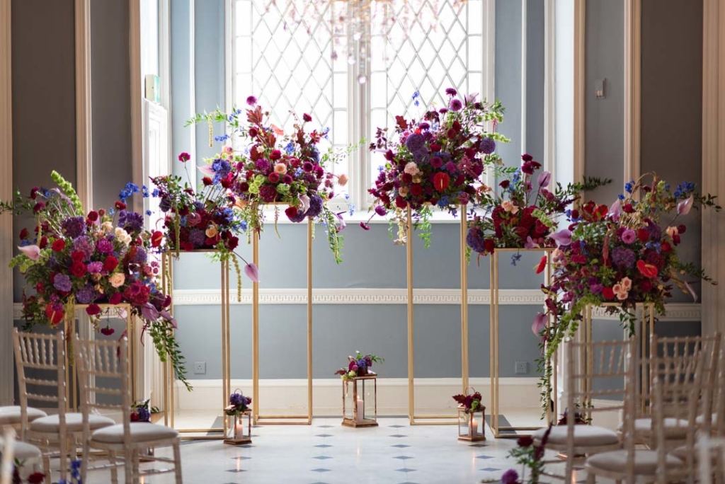 Flowers on geometric stands in ceremony room at Luttrellstown Castle