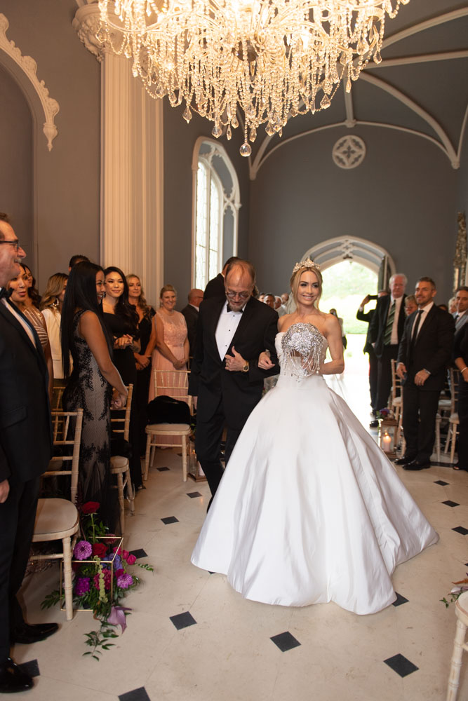 Bride and father of the Bride walking down aisle at Luttrellstown Castle