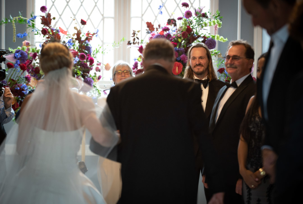 Groom looking back at Bride walking down aisle at Luttrellstown Castle