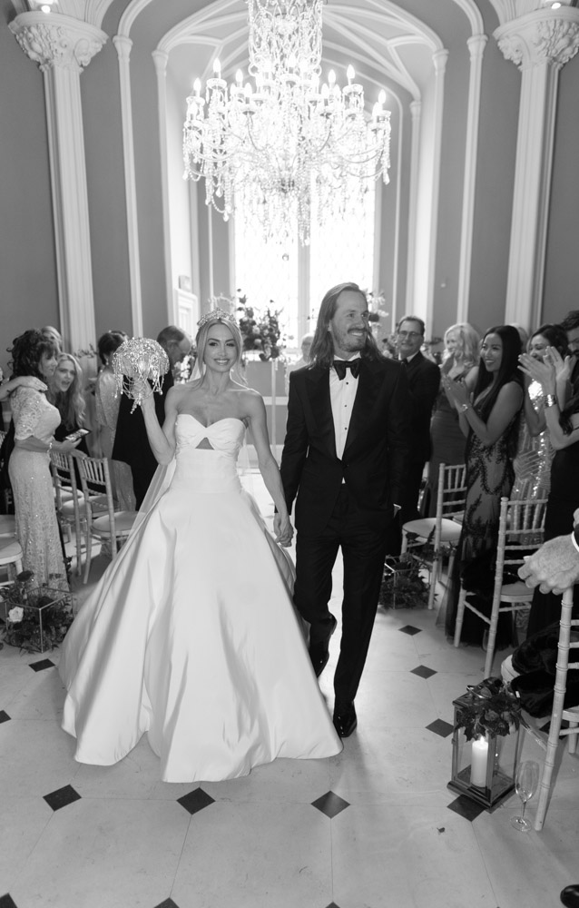 Bride and Groom smiling walking down aisle at Luttrellstown Castle ceremony room