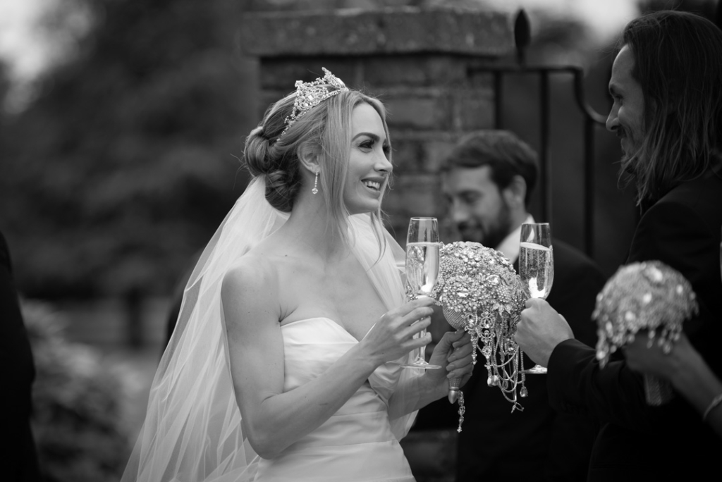 Bride and Groom clinking champagne glasses at Luttrellstown Castle