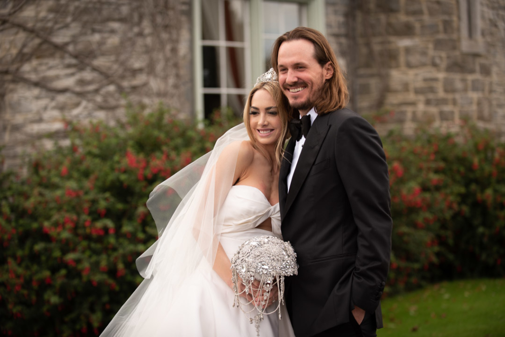 Bride and Groom hugging and smiling in garden at Luttrellstown Castle