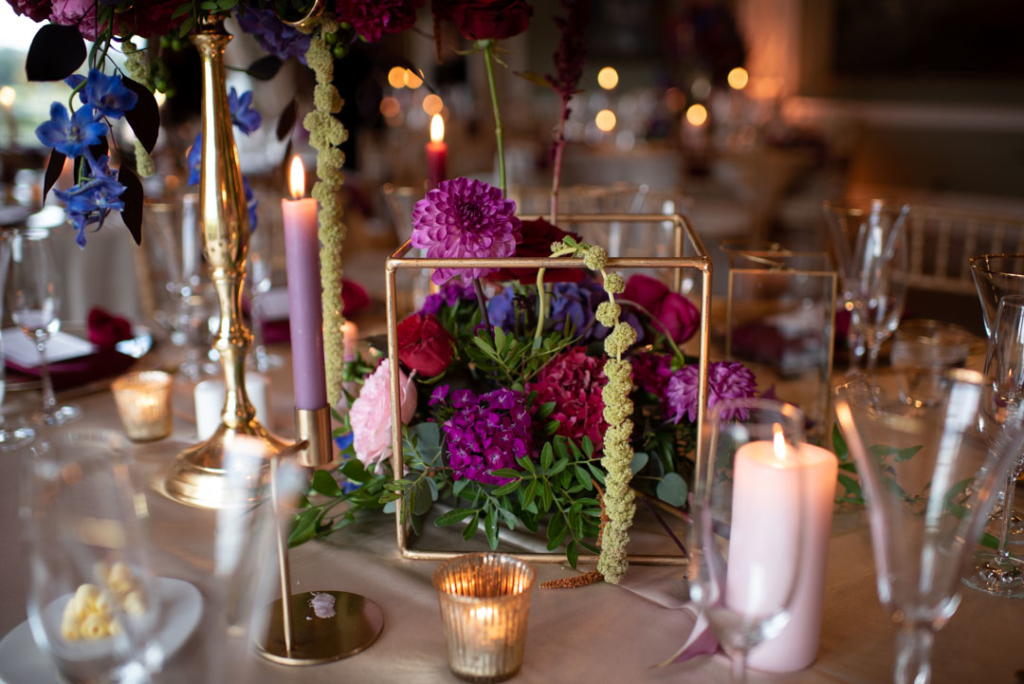 Flowers on table in a small square geometric stand