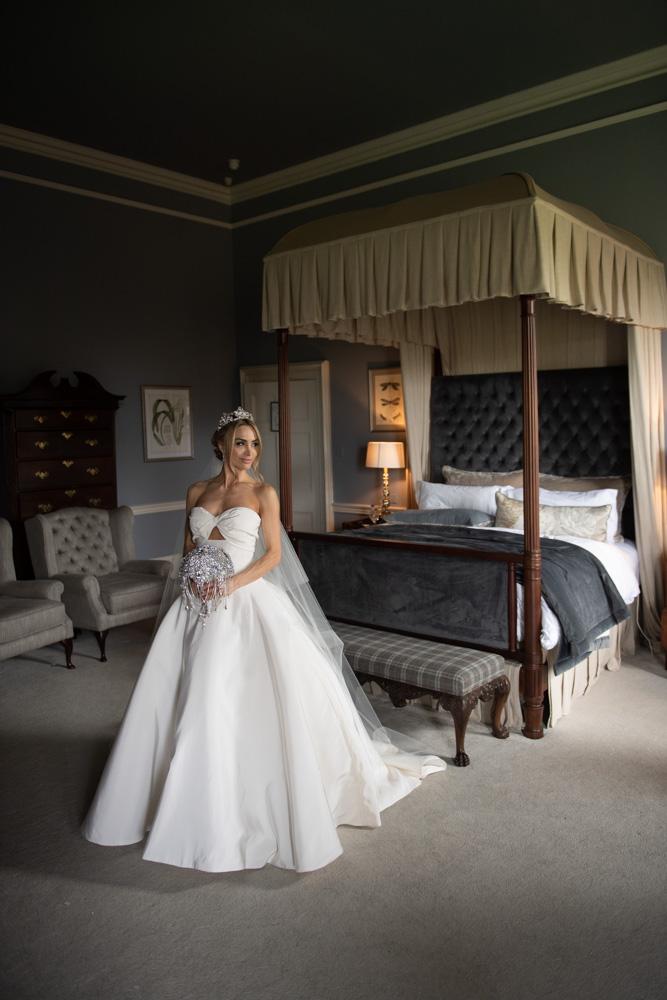 bride standing in Oscar De La Renta wedding dress in bridal suite