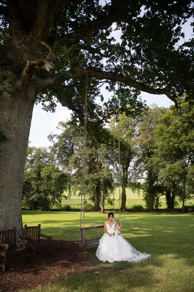 Bride sitting on swing for her Tankardstown House Wedding