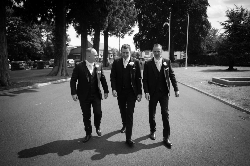 Groom and groomsmen arriving to church for his wedding