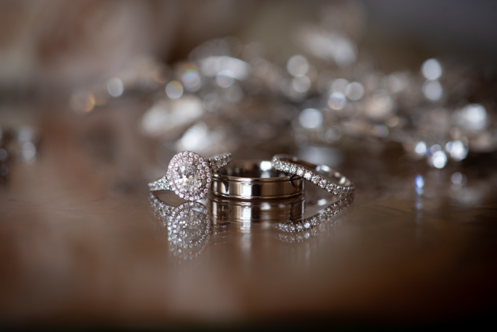 detail shot of engagement and wedding rings