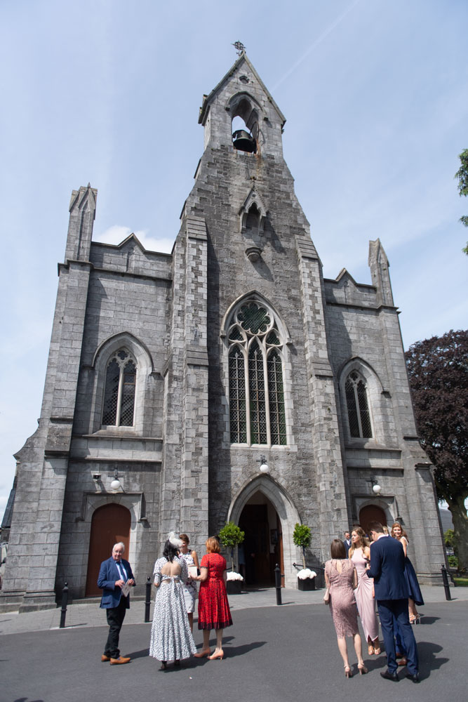 Church with guests outside for wedding