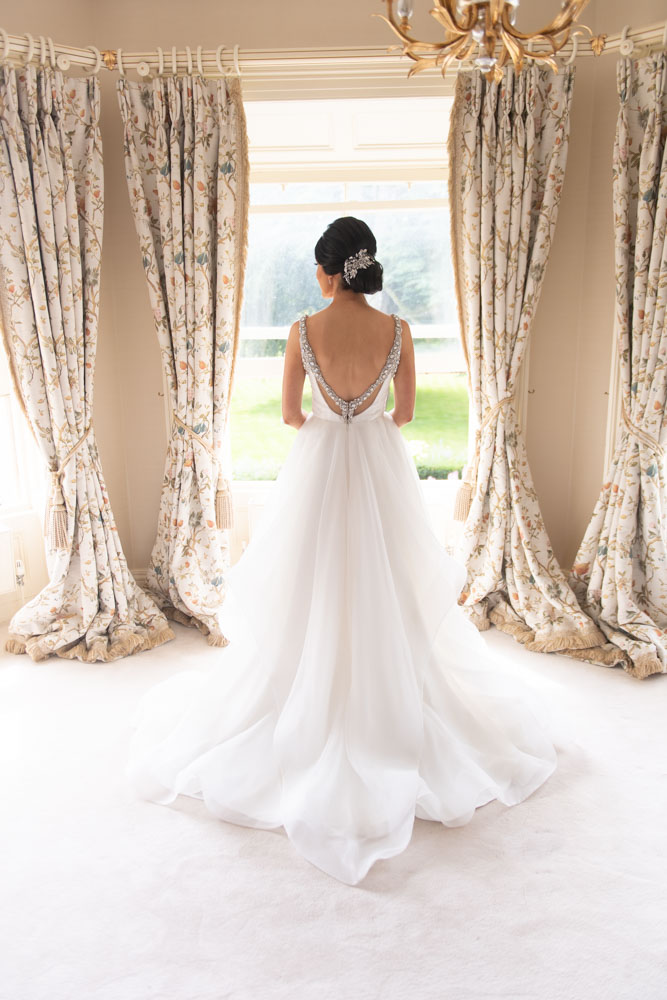 Bride standing looking out window at Tankardstown House